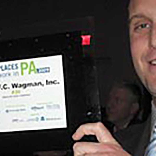 Mike Glezer accepts the Best Places to Work award