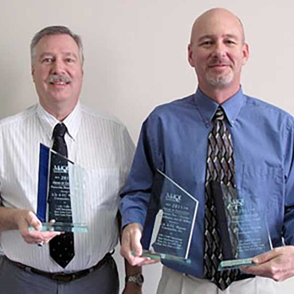 Wagman employees receive awards from MDQI