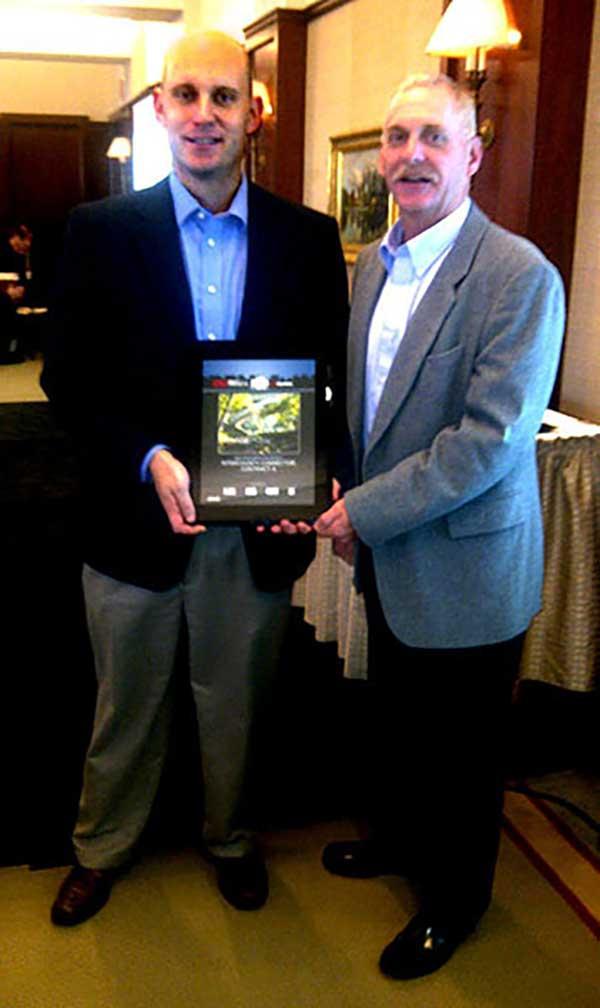 Mike Glezer and Todd Becker accept the ENR award