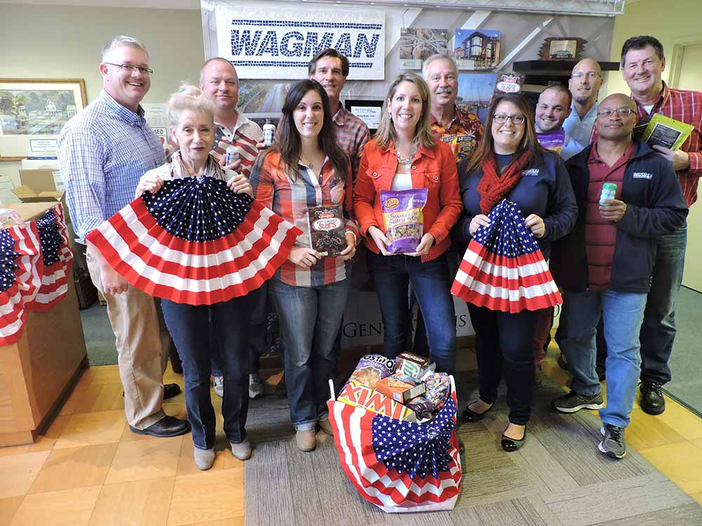 The Wagman Corporate Team makes a donation to SOAR