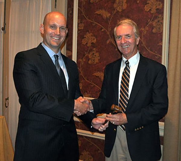 Mike Glezer accepts the gavel from Richard Wagman