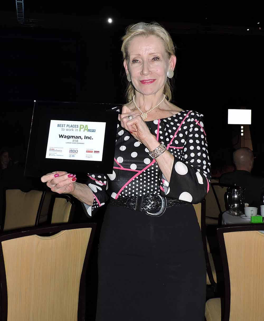 Sherry R accepts Wagman award for 2015 Best Places to Work